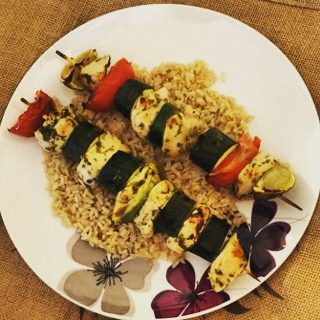 chicken kebabs on rice